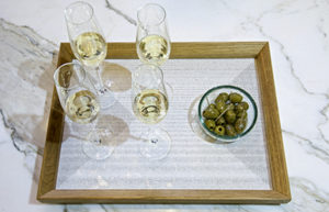 Situation of the oak service tray designed by Alix Welter. Alix Welter's Crystal I print collection