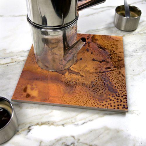"""Heating Love"" by Yannick Pirson on ceramic trivet"