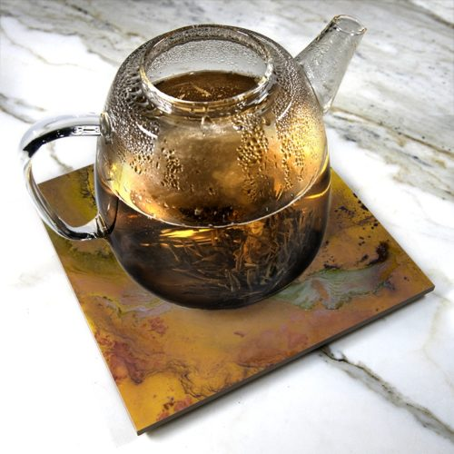 """Heating Love (Citrus)"" by Yannick Pirson on ceramic trivet"