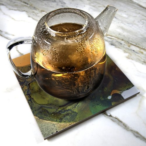 """Ool-d O Green"" by Yannick Pirson on ceramic trivet"